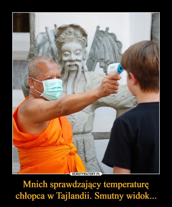 Mnich sprawdzający temperaturę chłopca w Tajlandii. Smutny widok... –